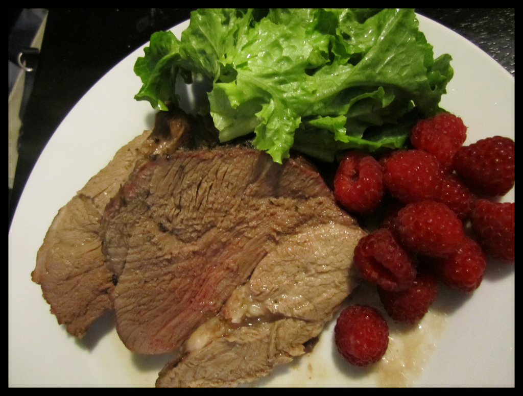 Garlic Stuffed Lamb Dinner with Raspberries and Lettuce