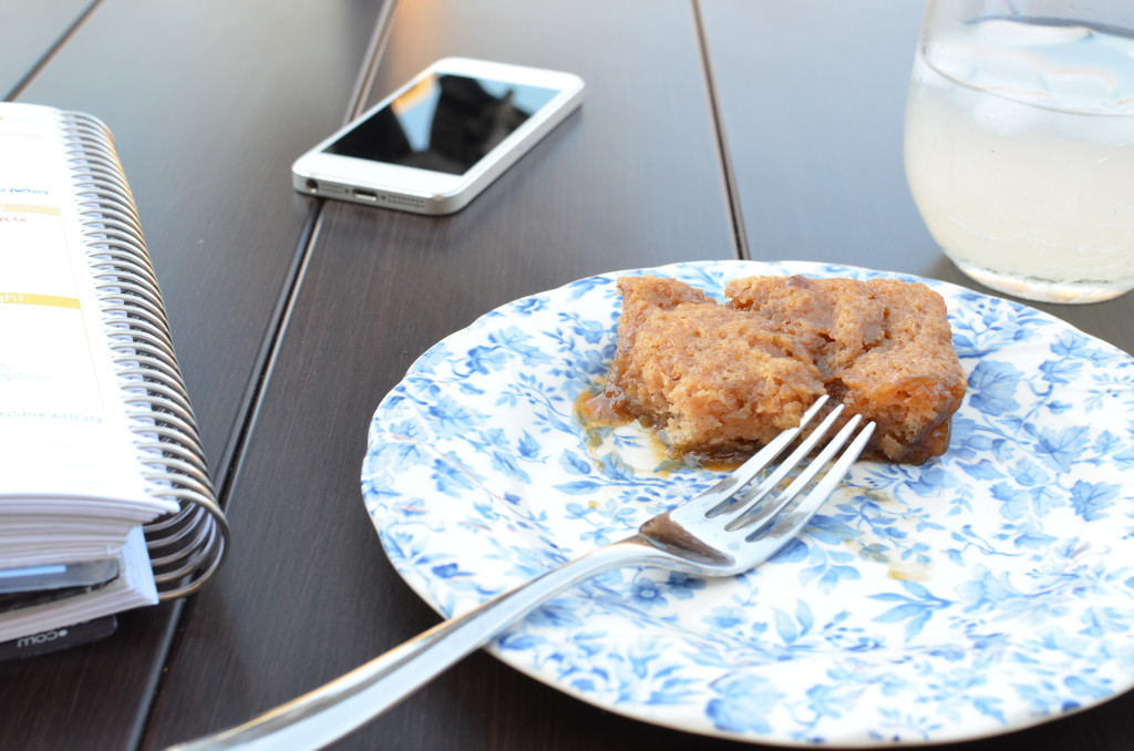 Morning prep with Snickerdoodle casserole with a form next to a phone and glass of lemonade.