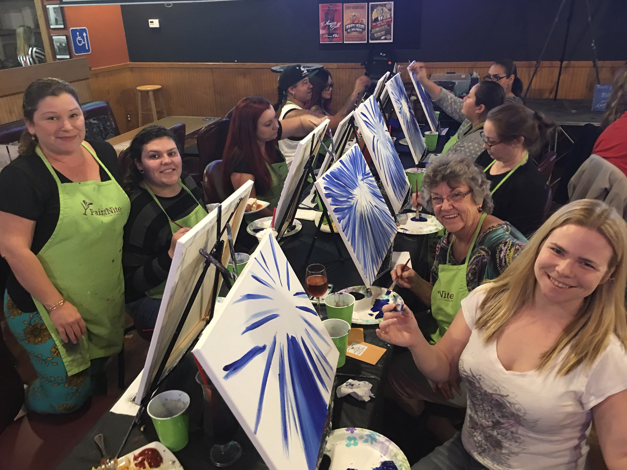 Paint Nite - Family out together making under water silhouette paintings. With wine!