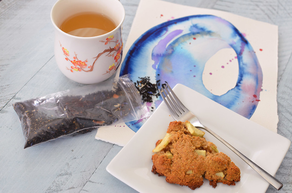 Cinnamon Apple Scones with tea over a watercolor painting