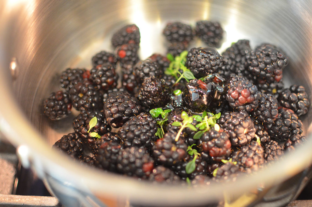 Wash and pat dry your blackberries and place in a medium saucepan. Add thyme, honey, and a pinch of salt.