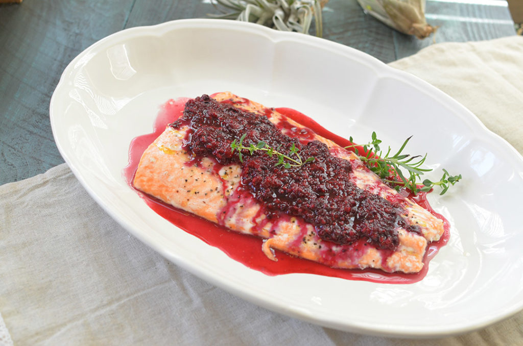 Pour blackberry sauce over salmon, but reserve some for additional toppings for individual plates.