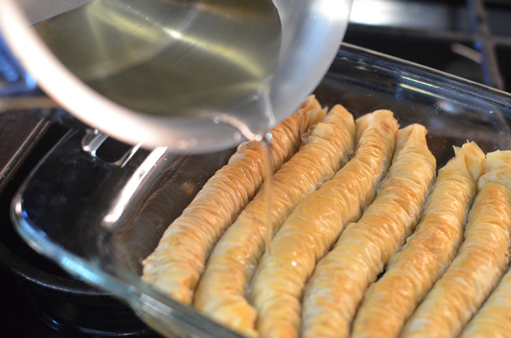 flakey baklava pour the syrup over them while they're still hot. You should hear them sizzle.