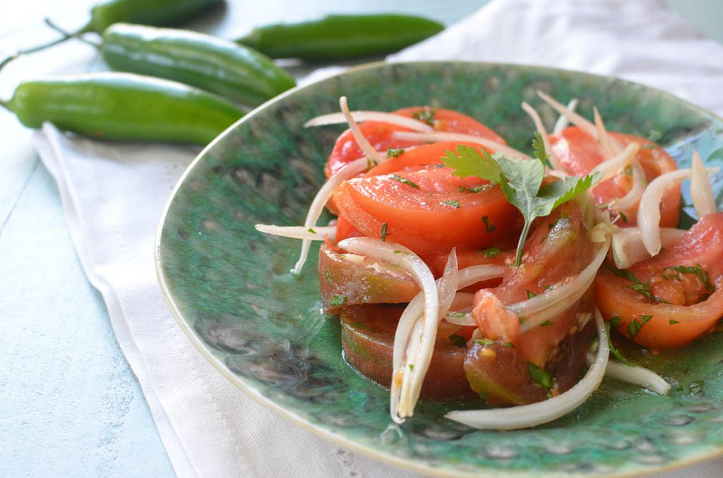 Ensalada Chilena! A refreshing and light salad for a hot day. Wonderfully savory flavor with juicy tomatoes and the sharp bite of the onions.