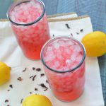 A refreshing summer drink made from fresh lemons and hibiscus petals